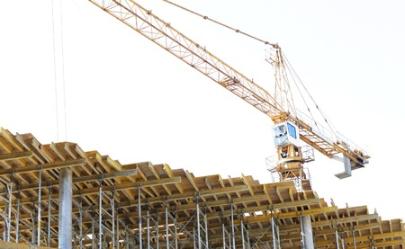 industry architecture: building, architecture, industry and engineering concept - crane at construction site Stock Photo