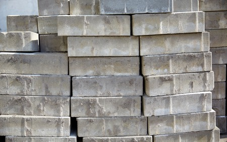 construction material: brickwork, construction and building material concept - batch of bricks