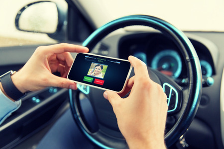 body parts cell phone: transport, business trip, communication, technology and people concept - close up of male hands with incoming video call icon on smartphone screen in car