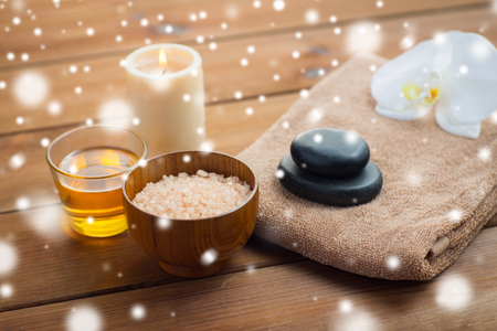 lastone therapy: beauty, spa, bodycare, natural cosmetics and concept - himalayan pink salt with honey in glass and bath towel on wooden table over snow