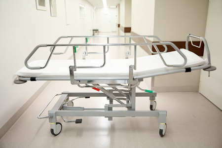 reanimation: healthcare, reanimation, emergency room and medicine concept - gurney or wheeled stretcher at hospital corridor Stock Photo