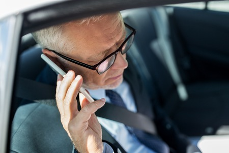 back seat: transport, business trip, technology and people concept - senior businessman calling on smartphone and driving on car back seat