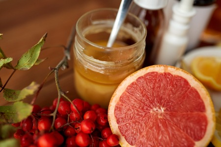 indigenous medicine: healthcare, traditional medicine and ethnoscience concept - grapefruit, honey with rowanberry and drugs