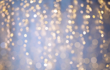 christmas backdrop: background, bokeh, holidays and backdrop concept - blue and yellow blurred christmas lights