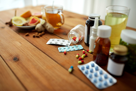 indigenous medicine: health, traditional medicine and ethnoscience concept - natural and synthetic drugs on wooden table Stock Photo