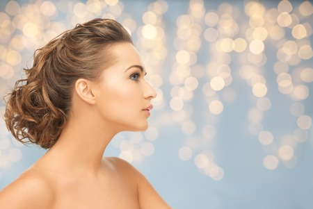 visage: health, people, plastic surgery, holidays and beauty concept - beautiful young woman face over lights background