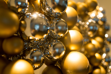 matt: holidays and luxury concept - close up of golden christmas decoration or garland of beads or balls Stock Photo