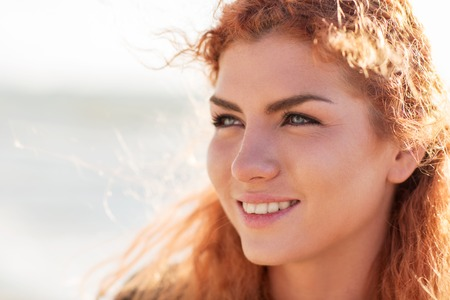 facial expression: people, facial expression and emotion concept - close up of happy young redhead woman face Stock Photo