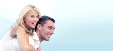 couple dating: summer holidays, celebration and dating concept - couple at seaside