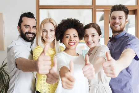 multiracial: business, startup, people and teamwork concept - happy creative team showing thumbs up in office