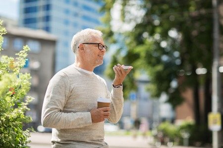 using voice: technology, senior people, lifestyle and communication concept - happy old man using voice command recorder or calling on smartphone outdoors
