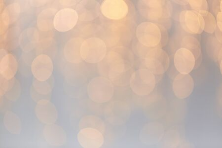 shimmering: holidays, background and illumination concept - blurred golden christmas decoration or garland lights bokeh Stock Photo