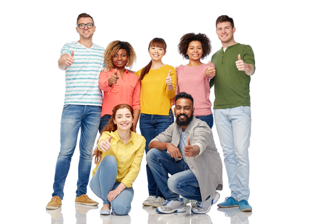 thumbs up group: diversity, race, ethnicity and people concept - international group of happy smiling men and women showing thumbs up over white