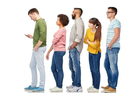 to queue: technology, ethnicity and people concept - international group of men and women in queue line with smartphone over white