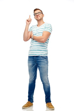 pointing finger up: people and idea concept - happy young woman pointing finger up over white