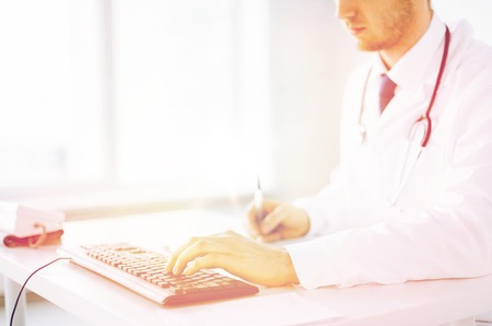 prescribing: close up of male doctor typing  on the keyboard Stock Photo