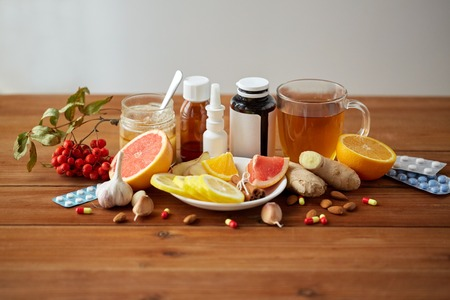 health, traditional medicine and ethnoscience concept - natural and synthetic drugs on wooden table Stock Photo