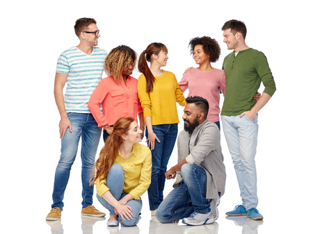 fashion clothes: diversity, race, ethnicity and people concept - international group of happy smiling men and women over white