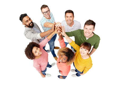 asian and indian ethnicities: diversity, race, ethnicity, gesture and people concept - international group of happy smiling men and women making high five over white Stock Photo