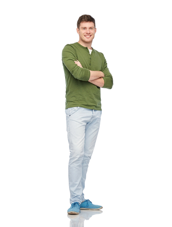 male, fashion and people concept - smiling young man over white