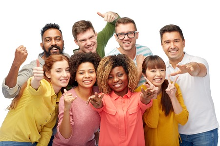 diversity, race, ethnicity and people concept - international group of happy smiling men and women showing thumbs up and peace over white Stockfoto