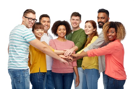 all smiles: diversity, teamwork, race, ethnicity and people concept - international group of happy smiling men and women holding hands together over white