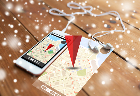 gprs: technology, navigation, gadget and object concept - close up of white smartphone and earphones on wooden surface with gps navigator map on screen