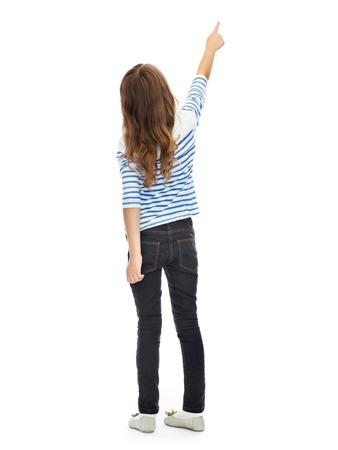 onderwijs, mensen en het concept kindertijd - meisje wijzende vinger op iets onzichtbaars over white