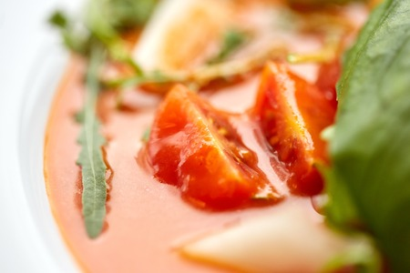 food, dinner, culinary, haute cuisine and cooking concept - close up of plate with delicious gazpacho soup at restaurant Stock Photo