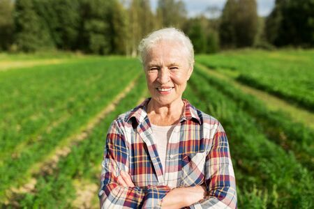 senior woman: farming, gardening, agriculture and people concept - happy senior woman at farm