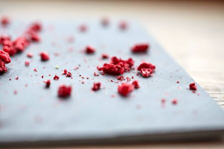 dried food: food and cooking concept - dried raspberries or berries on stone plate