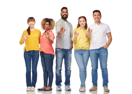 multiracial: diversity, race, ethnicity and people concept - international group of happy smiling men and women showing ok hand sign over white
