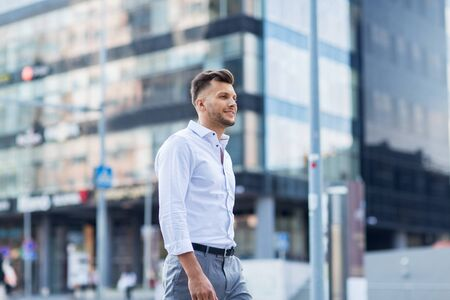 metrosexual: lifestyle and people concept - young man walking along city street