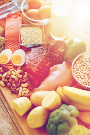 meat diet: balanced diet, cooking, culinary and food concept - close up of vegetables, fruits and meat on wooden table