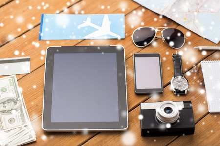 airplane ticket: tablet pc, smartphone, airplane ticket and camera Stock Photo