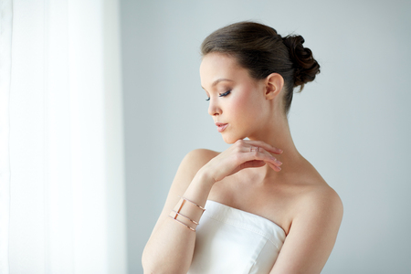 bride bangle: beautiful asian woman with ring and bracelet