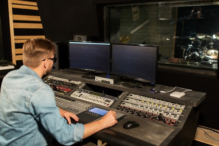 man at mixing console in music recording studio Standard-Bild