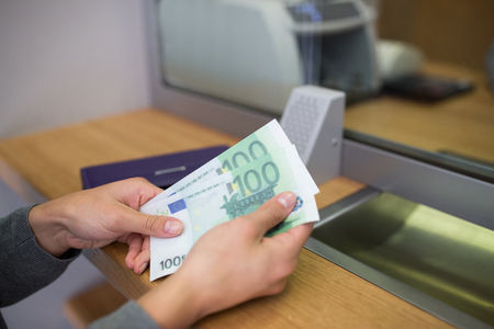 exchanger: hands with money at bank or currency exchanger Stock Photo