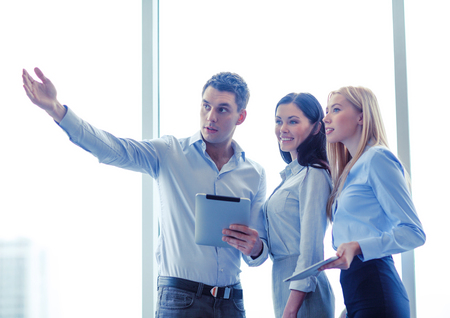 group goals: business team working with tablet pcs in office Stock Photo
