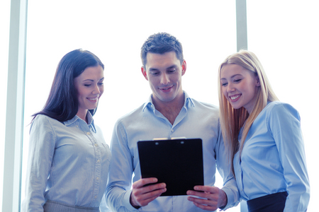 common goal: business team looking at clipboard