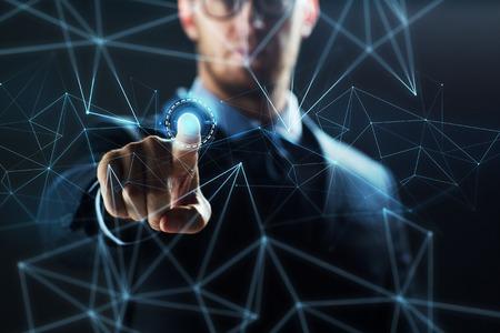 仮想ネットワークのホログラムを持ったビジネスマン 写真素材