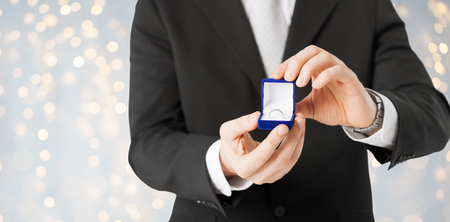 verlobung: close up of man with engagement ring in gift box