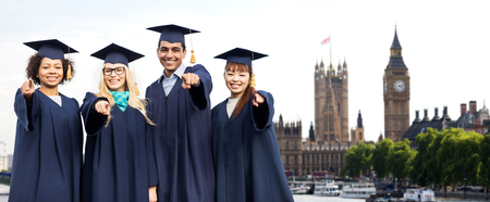 uk: students or bachelors pointing at you in london Stock Photo