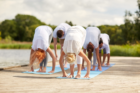 group of people making yoga exercises outdoors Imagens