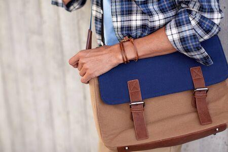 shoulder bag: close up of hipster man with stylish shoulder bag Stock Photo