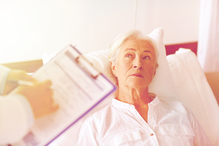 hospital patient: doctor visiting senior woman patient at hospital Stock Photo