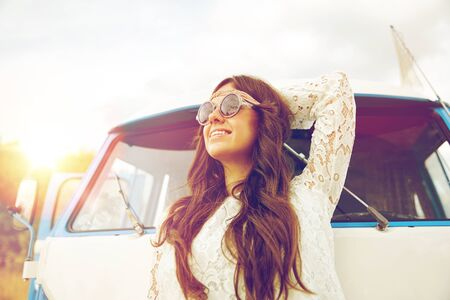 smiling young hippie woman in minivan car Stock Photo