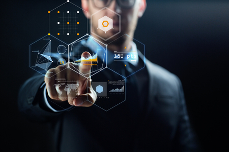 close up of businessman with virtual charts