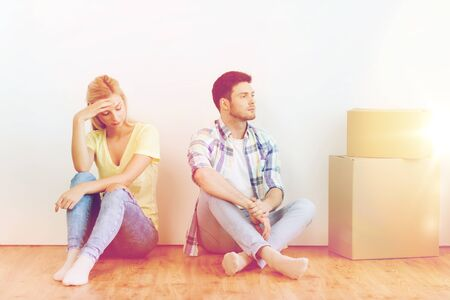 moving out: unhappy couple having argument at home