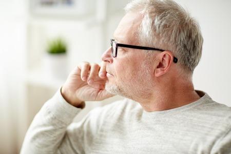 businessman thinking: close up of senior man in glasses thinking